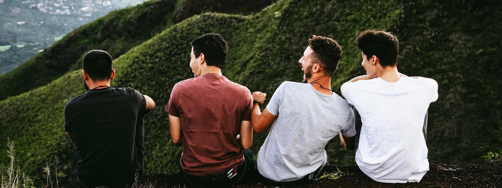 image of guys on hillside